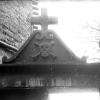 Detail of the cemetery gate installed by Saunière with skull and crossbones