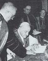Pope John XXIII, signing the enciclica Pacem in Terris