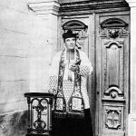 Saunière at the porch of his finished Church