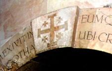 Jerusalem Cross on keystone over the entrance to the chapels at the summit of Golgotha (Jerusalem)