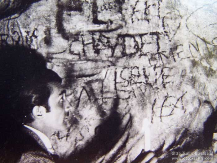 Otto Rahn looking a graffiti in a cave