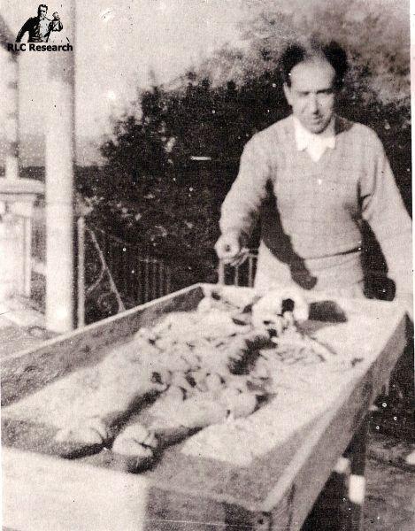Noel Corbu posing with a skeleton he found during a traesure dig