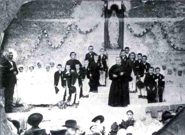 1891, 24 children of the village celebrate First Communion with their priest Bérenger Saunière