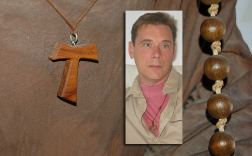 A penitent Franciscan habit with a Tau cross and Karl Hammer-Kaatee