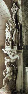 statue group of the devil conquered by the angels making the sign of the cross