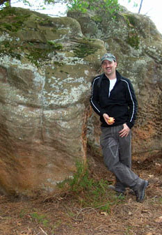 Your webmaster eating an apple at the ALCOR stone