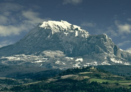 Mount Bugarach facing up to the sky with Rennes-le-Château in the foreground