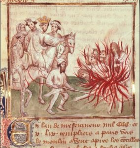 Cathars burnt at the stake under the watchful eye of the French King