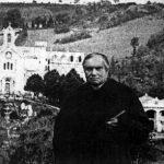 """Louis de Coma posing at the inauguration of his """"Pélerinage de Carol"""""""